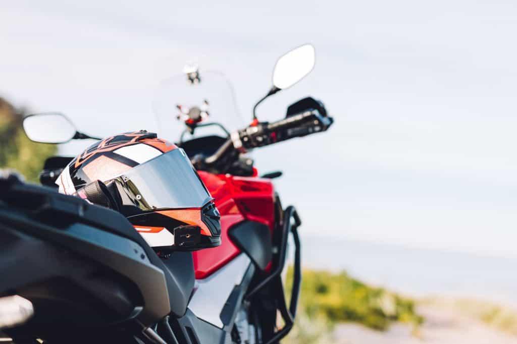 Adventure motorbike on grassy roadside. Offroad trip