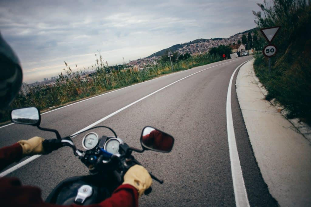 POV motorcycle driver on empty road